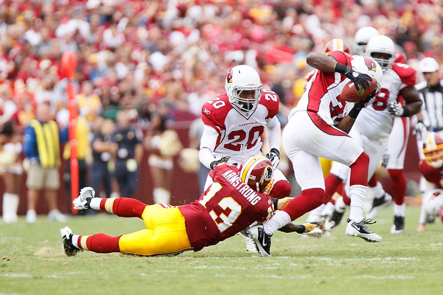 Arizona Cardinals' cornerback Richard Marshall intercepts a pass from Redskins' quarterback Rex Grossman at the Arizona 39-yard line to kill the second Redskins' drive of the first quarter at FedEx Field in Landover, Md., on Sunday, September 18, 2011. (T.J. Kirkpatrick/The Washington Times)