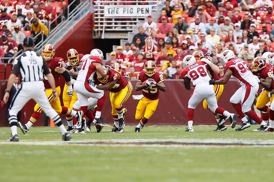 Redskins' running back Tim Hightower (25) breaks through a hole against his old team the Arizona Cardinals during the first quarter at FedEx Field in Landover, Md., on Sunday, September 18, 2011. (T.J. Kirkpatrick/The Washington Times)