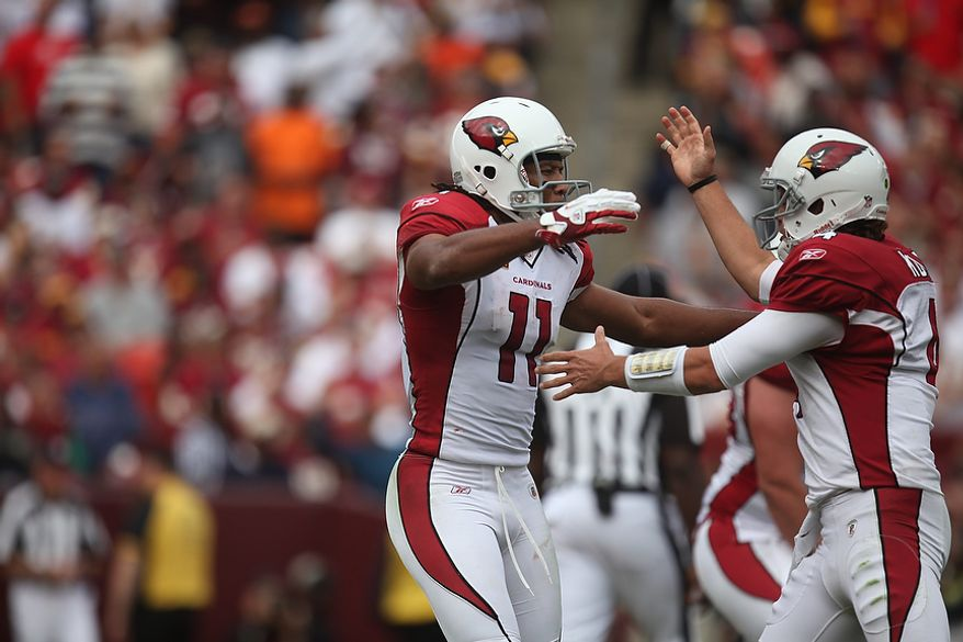 Arizona Cardinals' quarterback Kevin Kolb (4) celebrates with wide receiver Larry Fitzgerald after they connected for a 73-yard touchdown pass to start the fourth quarter at FedEx Field in Landover, Md., on Sunday, September 18, 2011. (Pratik Shah/The Washington Times)