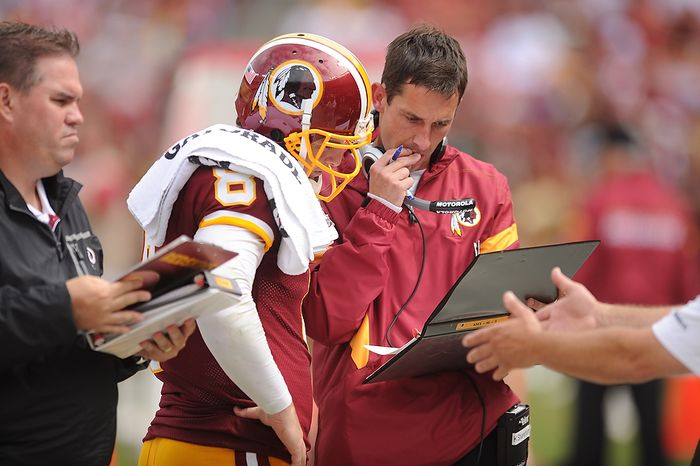 Washington Redskins offensive coordinator Kyle Shanahan talks with quarterback Rex Grossman (8) during a timeout in the second quarter against the Arizona Cardinals at FedEx Field in Landover, Md., on Sunday, Sept. 18, 2011. (Andrew Harnik/The Washington Times)