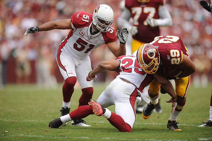 Washington Redskins running back Roy Helu (29) is tackled by Arizona Cardinals free safety Kerry Rhodes (25) on a third-quarter run against the Cardinals at FedEx Field in Landover, Md., on Sunday, Sept. 18, 2011. (Andrew Harnik/The Washington Times)