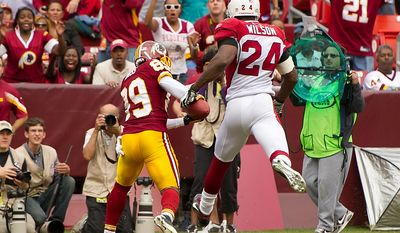 Washington Redskins WR Santana Moss (89) pulls in an 18-yard touchdown in the fourth quarter against Arizona Cardinals SS Adrian Wilson (24) at FedEx Field in Landover, Md., on Sunday, Sept. 18, 2011. (Andrew Harnik/The Washington Times)