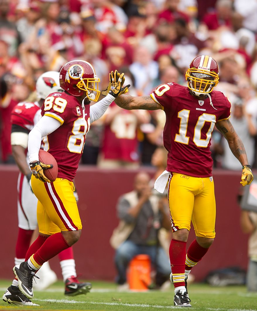 Washington Redskins WR Santana Moss (89) celebrates with his teammate WR Jabar Gaffney (10) after an 18-yard touchdown in the fourth quarter against the Arizona Cardinals at FedEx Field in Landover, Md., on Sunday, Sept. 18, 2011. (Andrew Harnik/The Washington Times)