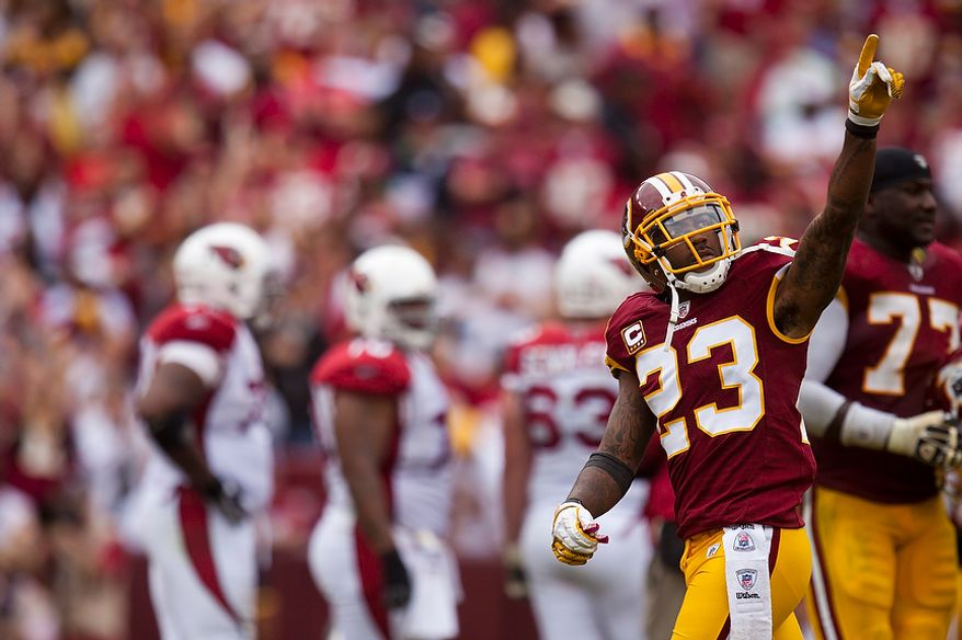 Washington Redskins cornerback DeAngelo Hall (23) pumps up the crowd after the Redskins recovered a fumble during the fourth quarter of a game with the Arizona Cardinals at FedEx Field in Landover, Md., on Sunday, Sept. 18, 2011. (Pratik Shah/The Washington Times)
