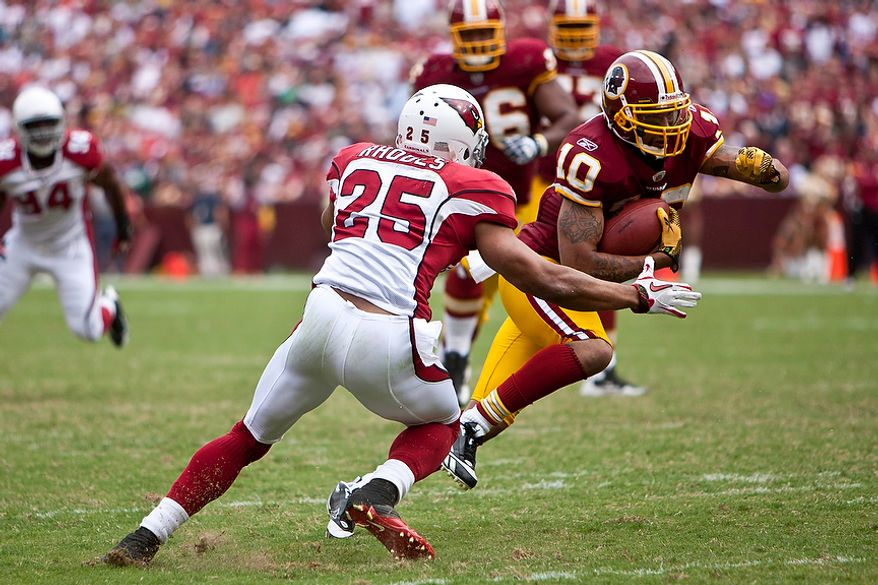 Washington Redskins wide receiver Jabar Gaffney (10) tries to dodge Arizona Cardinals free safety Kerry Rhodes (25) for a 4-yard gain to set up a Redskins field goal early in the fourth quarter as the Redskins beat the Cardinals 22-21 at FedEx Field in Landover, Md., on Sunday, Sept. 18, 2011. (T.J. Kirkpatrick/The Washington Times)