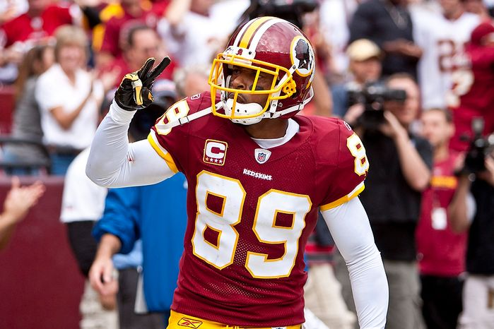 Washington Redskins wide receiver Santana Moss (89) celebrates a touchdown after an 18-yard run in the fourth quarter as the Redskins beat the Arizona Cardinals 22-21 at FedEx Field in Landover, Md., on Sunday, Sept. 18, 2011. (T.J. Kirkpatrick/The Washington Times)
