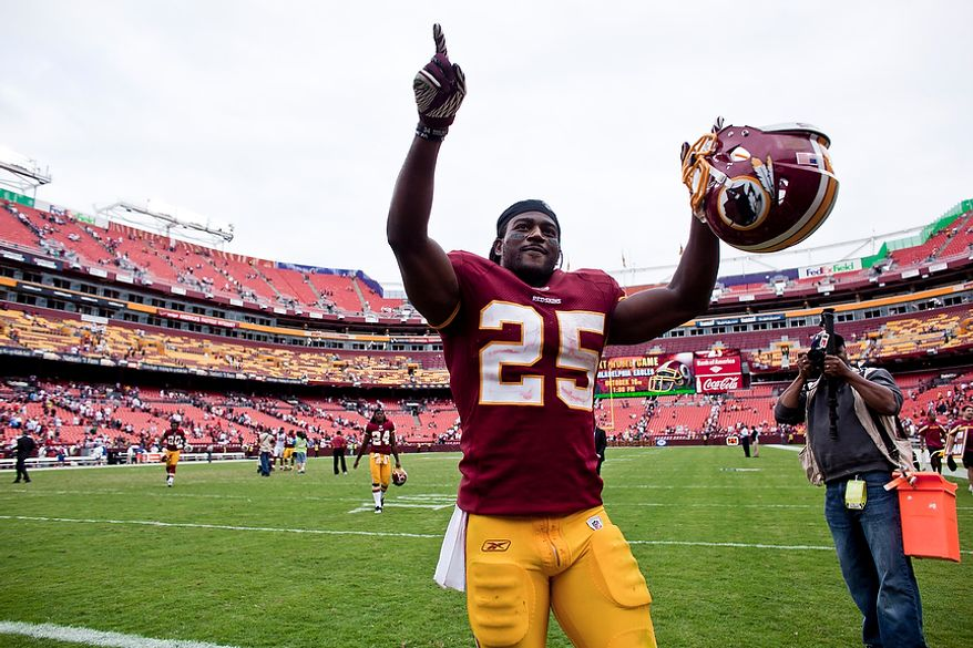Washington Redskins running back Tim Hightower (25) celebrates at the end of the fourth quarter as the Redskins beat the Arizona Cardinals 22-21 at FedEx Field in Landover, Md., on Sunday, Sept. 18, 2011. (T.J. Kirkpatrick/The Washington Times)
