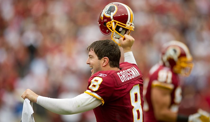 Washington Redskins QB Rex Grossman (8) celebrates after referees review an incomplete pass and rule that it was instead a fumble, giving the Redskins the ball with a minute and a half left in the fourth quarter against the Arizona Cardinals at FedEx Field in Landover, Md., on Sunday, Sept. 18, 2011. (Andrew Harnik/The Washington Times)