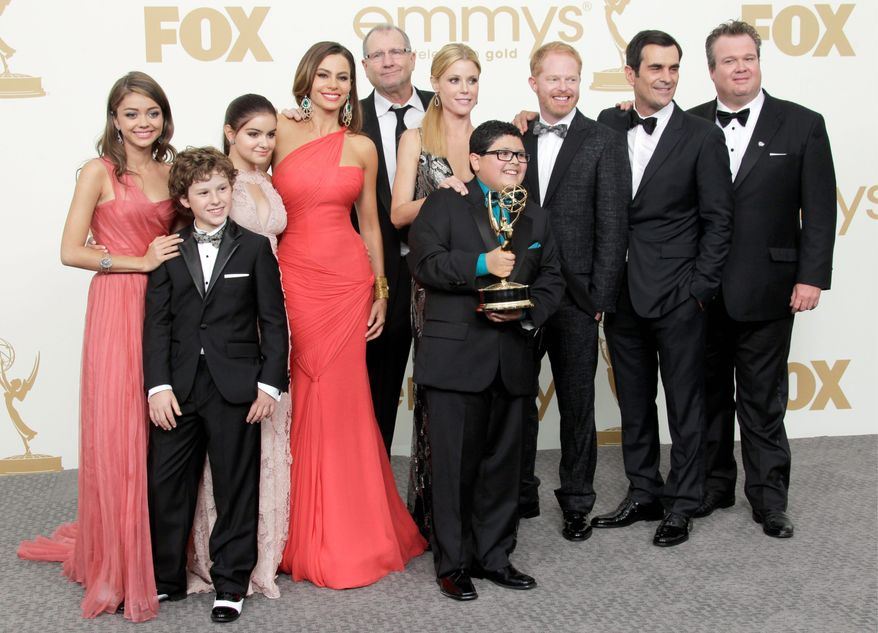 "Sunday turned out to be family night for the cast of ""Modern Family."" The show won five Emmys, including best comedy, best supporting actor and actress and best writing and direction. That gave ABC the most Emmys, breaking HBO's eight-year winning streak. (Associated Press)"