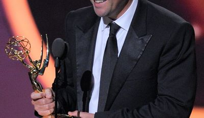 "Kyle Chandler, who played a high school football coach in ""Friday Night Lights,"" holds his Emmy for lead actor in a drama series. ""I knew for a fact I would not be standing here. I did not write anything,"" he said. (Associated Press)"