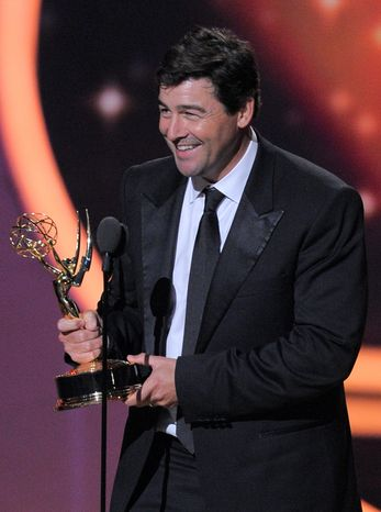 """Kyle Chandler, who played a high school football coach in """"Friday Night Lights,"""" holds his Emmy for lead actor in a drama series. """"I knew for a fact I would not be standing here. I did not write anything,"""" he said. (Associated Press)"""