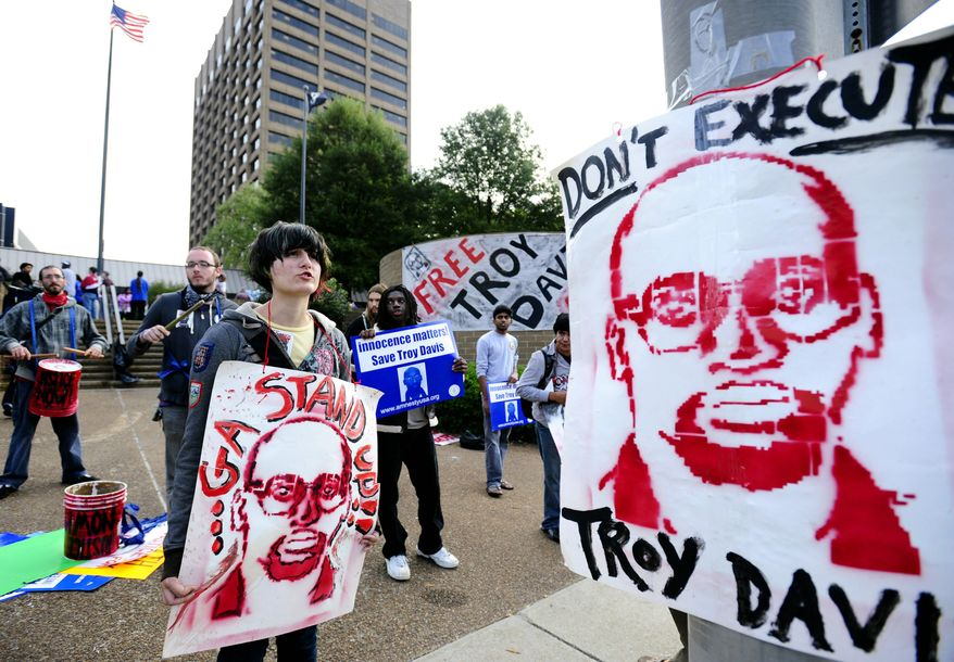 Supporters of death-row inmate Troy Davis gather outside the Atlanta building Monday where the Georgia Board of Pardons and Paroles is holding a hearing on whether to change his death sentence for the 1989 slaying of a Savannah, Ga., police officer. (Associated Press)