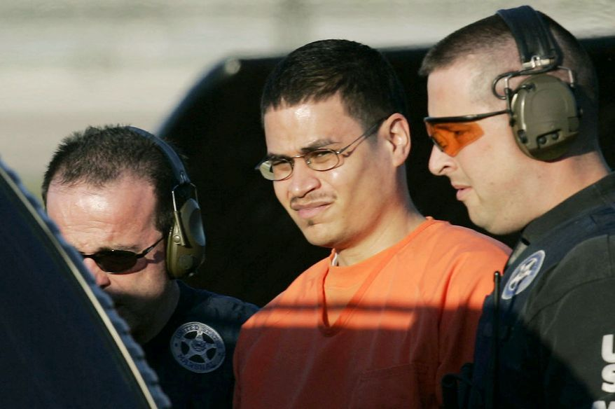 ASSOCIATED PRESS Jose Padilla is escorted to a waiting police vehicle by federal marshals in 2003. Four years later, he was sentenced to 17 years in prison on terrorism-related charges. On Monday, an appeals court ordered a new sentencing, calling the original term too lenient.