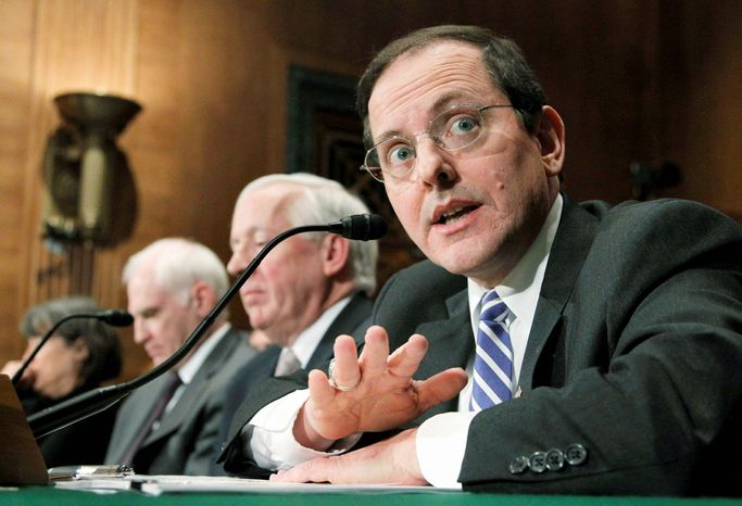 Edward DeMarco, acting director of the Federal Housing Finance Agency, says reshaping Fannie Mae and Freddie Mac requires spreading lending risks. (Associated Press)