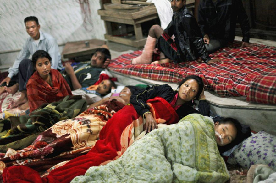 Residents and patients from a local hospital take shelter in a Hindu temple on Monday, Sept. 19, 2011, after Sunday's earthquake in Gangtok, India. (AP Photo/Altaf Qadri)