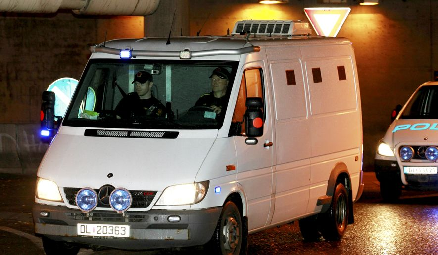 A police van takes Norwegian mass killer Anders Behring Breivik to court in Oslo on Monday, Sept. 19, 2011. (AP Photo/Terje Bendiskby, Scanpix)
