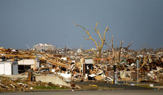 ASSOCIATED PRESS A Joplin, Mo., neighborhood devastated by a tornado that killed 162 people in May is seen a week later. A report from the National Oceanic and Atmospheric Administration says residents did not take shelter after first alarms.