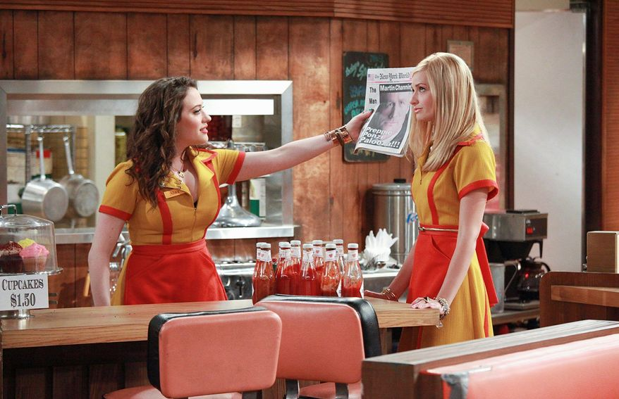 """CBS VIA ASSOCIATED PRESS Kat Dennings (left) and Beth Behrs star in CBS' new comedy """"2 Broke Girls."""" Miss Dennings says she can relate to her character's money issues."""