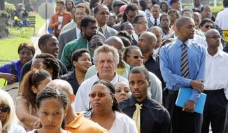 A job fair in Los Angeles last month drew crowds of people looking for work. The International Monetary Fund and the Obama administration have projected the national unemployment rate to average about 9 percent next year. (Associated Press)