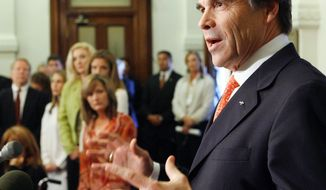 Texas Gov. Rick Perry speaks to reporters May 8, 2007, in Austin, Texas, after letting stand a bill that blocked state officials from following his executive order requiring an anti-cancer vaccine for sixth-grade schoolgirls. Some of the women in the background on the left had contracted the human papillomavirus (HPV). (Associated Press)