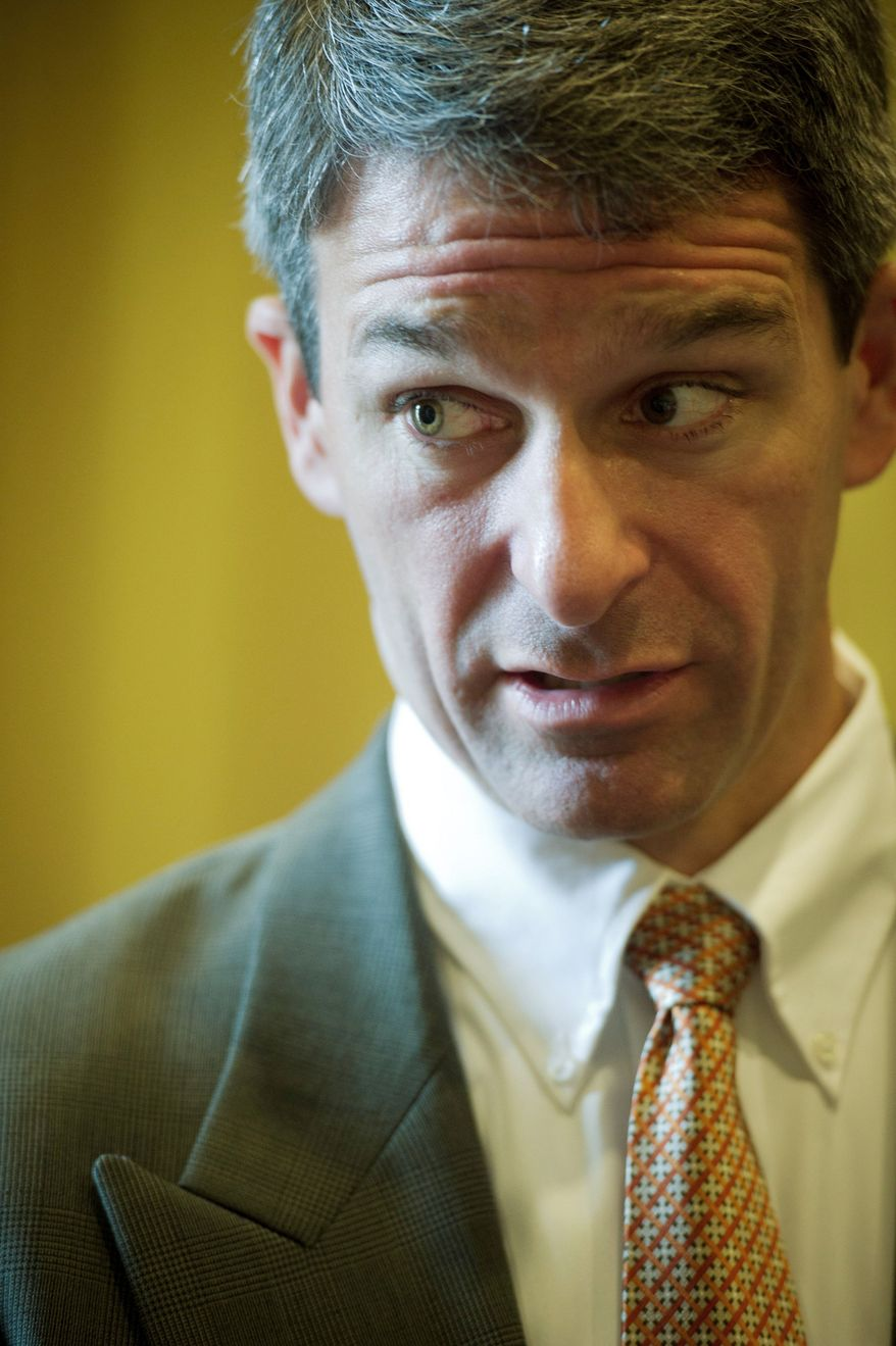 Virginia Attorney General Kenneth T. Cuccinelli II wants to deputize members of the state's Medicaid Fraud Control Unit so they can serve subpoenas and carry a weapon. (Rod Lamkey Jr./The Washington Times)