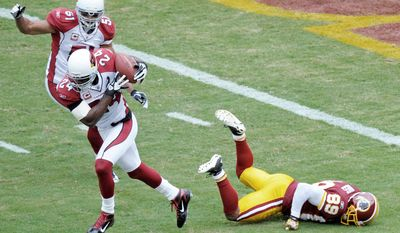 ASSOCIATED PRESS Cardinals safety Adrian Wilson snuffed out a red zone possession with this interception of Redskins quarterback Rex Grossman on Sunday.