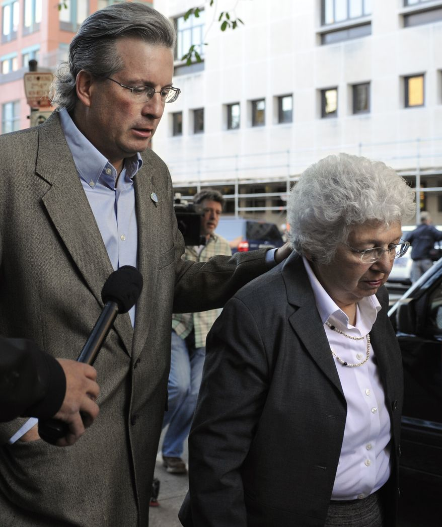 Dr. William Petit Jr. (left) and his mother, Barbara Petit, arrive at New Haven Superior Court in New Haven, Conn., on Monday, Sept. 19, 2011, for the first day of the trial of Joshua Komisarjevsky. (AP Photo/Jessica Hill)