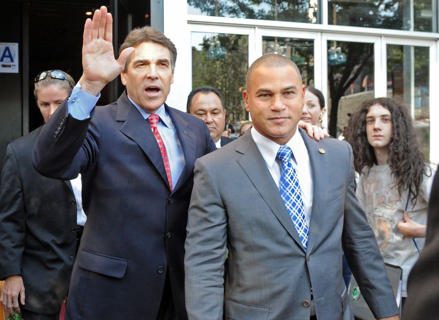 Republican presidential candidate Texas Gov. Rick Perry, left, heads to his vehicle after exiting the Papasito Restaurant in the Inwood section of the Manhattan borough of New York, Monday, Sept. 19, 2011. Wading into a tense foreign policy dispute, Mr. Perry and former Gov. Mitt Romney on Tuesday criticized the Palestinian Authority's effort to seek a formal recognition of statehood by the U.N. General Assembly. The GOP rivals also used the jockeying at the U.S. to assail President Barack Obama's policy toward Israel.  (AP Photo/Louis Lanzano)