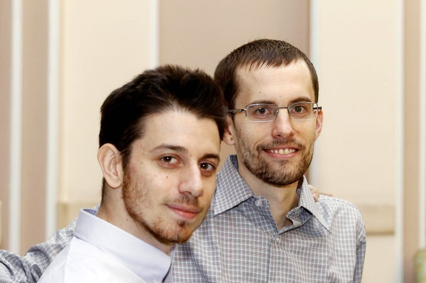 Josh Fattal (left) and Shane Bauer are shown at Tehran's Mehrabad airport on Wednesday before leaving for Oman after being freed by Iran from custody. The release of the two Americans, imprisoned by Iranian authorities as spies, ended a high-profile drama that lasted more than two years. (Islamic Republic News Agency via Associated Press)