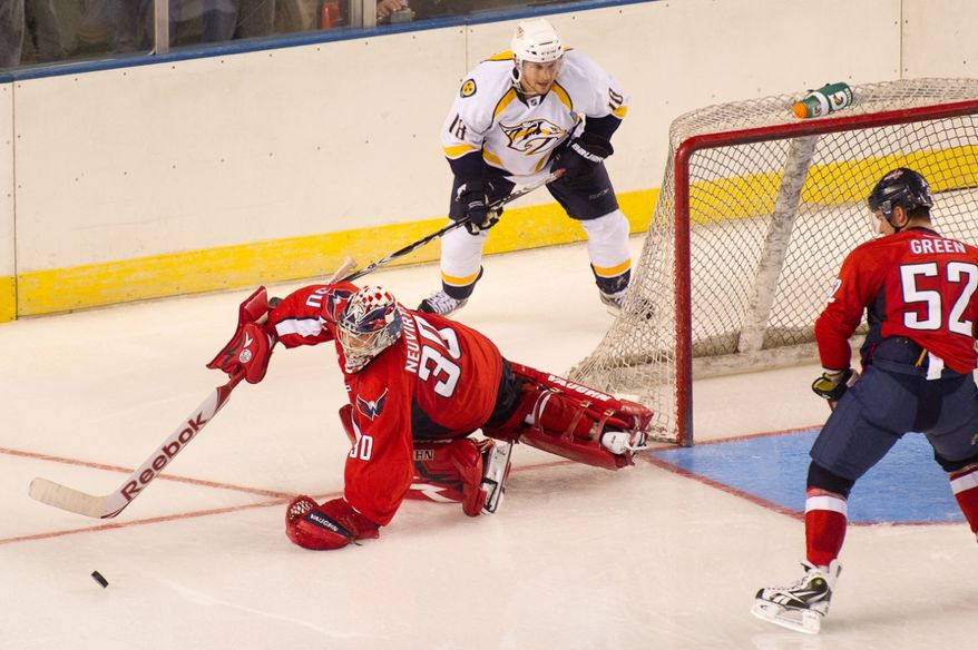 Goalie Michal Neuvirth (30) of the Washington Capitals chases after a loose puck in the second period of the Washington Capitals loss to the Nashville Predators, 2-0, in a preseason exhibition game at the 1st Mariner Arena, Baltimore, MD, Tuesday, September 20, 2011. (Andrew Harnik/The Washington Times)