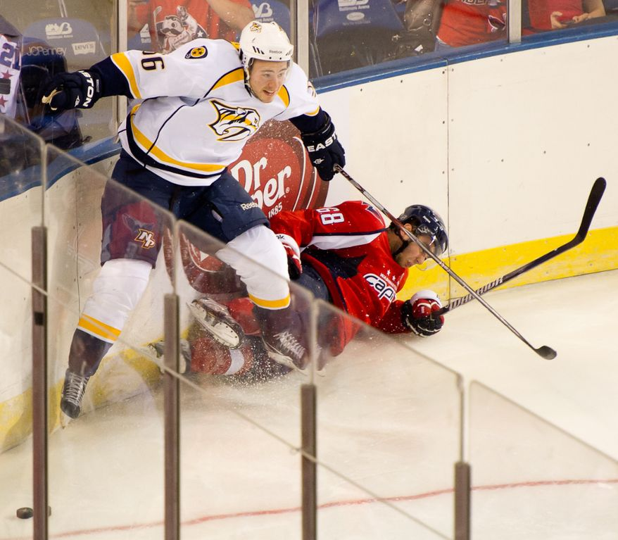 Zach Miskovic (68) of the Washington Capitals and Taylor Beck (56) of the Nashville Predators crash into the wall in the second period of the Washington Capitals loss to the Nashville Predators, 2-0, in a preseason exhibition game at the 1st Mariner Arena, Baltimore, MD, Tuesday, September 20, 2011. (Andrew Harnik/The Washington Times)