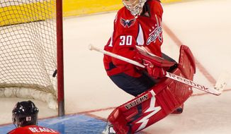 Washington Capitals goalie Michal Neuvirth (30) watches the puck go by him during a preseason loss to the Nashville Predators at the 1st Mariner Arena in Baltimore on Sept. 20, 2011. (Andrew Harnik/The Washington Times)