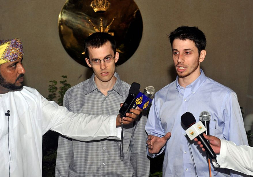 Freed Americans Shane Bauer (center) and Josh Fattal (right) talk to the media upon their arrival in Muscat, Oman, from Tehran on Wednesday, Sept. 21, 2011. After more than two years in Iranian custody, the two Americans, who were convicted as spies, took their first steps toward home as they bounded down the stairs from a private jet and into the arms of family for a joyful reunion in the Gulf state of Oman. (AP Photo/Sultan Al-Hasani)