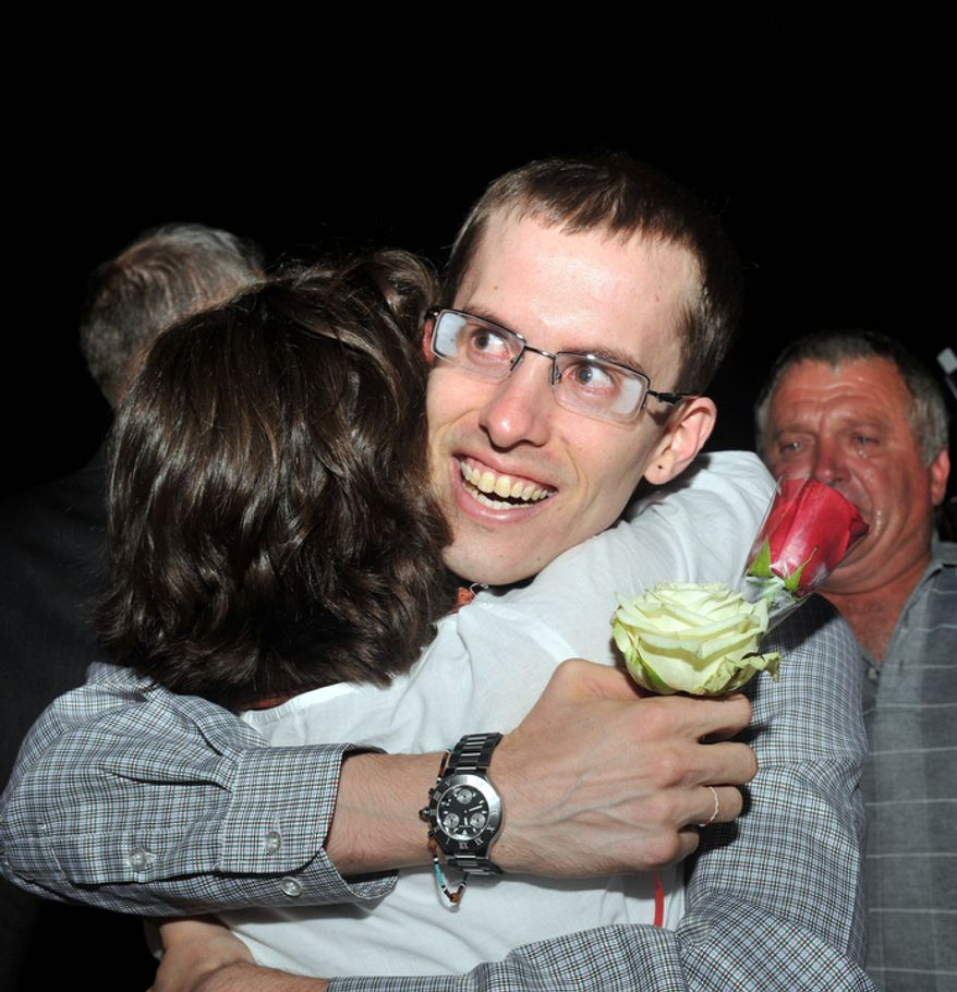 Freed American Shane Bauer is welcomed upon his arrival in Muscat, Oman, on Wednesday, Sept. 21, 2011. (AP Photo/Sultan Al-Hasani)
