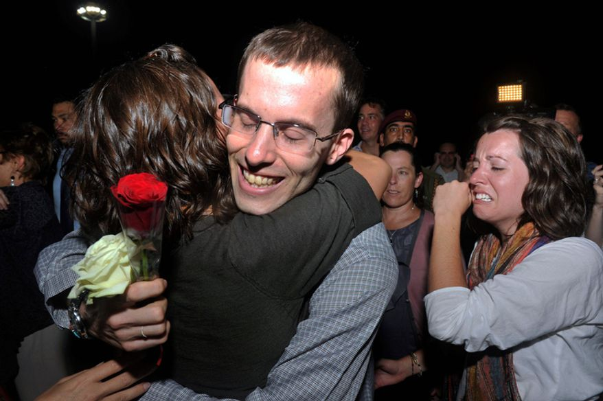 Freed American Shane Bauer (center) is welcomed upon his arrival in Muscat, Oman, from Tehran on Wednesday, Sept. 21, 2011. (AP Photo/Sultan Al-Hasani)