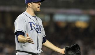 Tampa Bay Rays starting pitcher Wade Davis reacts to a call at first base during the second inning of a baseball game against the New York Yankees on Tuesday, Sept. 20, 2011, at Yankee Stadium in New York. The Yankees won 5-0. (AP Photo/Frank Franklin II)