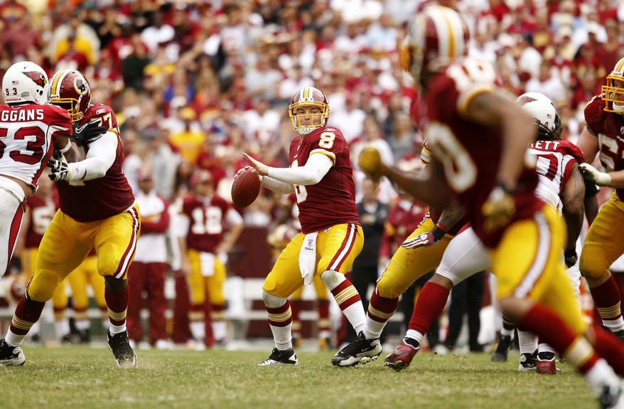 Washington Redskins' quarterback Rex Grossman (8) looks for a receiver in the second half of an NFL football game against the Arizona Cardinals in Landover, Md., Sunday, Sept. 18, 2011. (AP Photo/Evan Vucci)