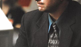 ** FILE ** Lawrence Russell Brewer listens to the guilty verdict in his capital murder trial at the Brazos County Courthouse in Bryan, Texas, in September 1999. (AP Photo/Butch Ireland, Pool)
