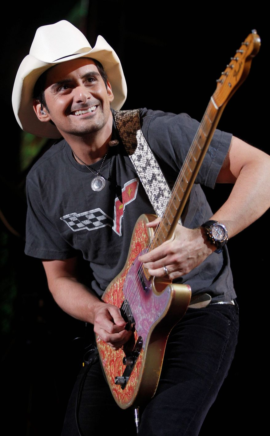 """FILE - In this June 9, 2011 file photo, Brad Paisley performs during the CMA Fan Festival in Nashville, Tenn. Paisley is releasing his first book on Nov. 1 called """"Diary of a Player"""". (AP Photo/Wade Payne, file)"""
