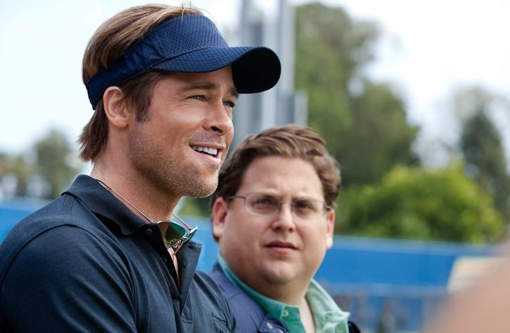 COLUMBIA PICTURES-SONY PHOTOGRAPHS VIA ASSOCIATED PRESS Brad Pitt (above, left) portrays A's general manager Billy Beane, and Jonah Hill plays a sidekick fictional Yale grad in economics.