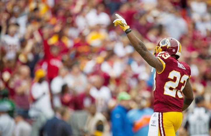 """Says Redskins defensive coordinator Jim Haslett of the statement by DeAngelo Hall (above) that he would go after Cowboys quarterback Tony Romo's broken rib: """"He's not allowed to hit him in the head. And he can't hit him below the knees. So he's only got one place you can hit him. It's such a shame he's hurt."""" (Pratik Shah/The Washington Times)"""