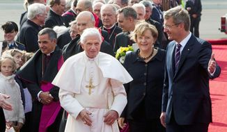 ASSOCIATED PRESS German President Christian Wulff and Chancellor Angela Merkel welcome Pope Benedict XVI at Berlin's airport on Thursday, the start of a four-day visit.