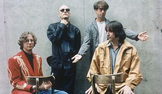 """In this 1994 file photo originally released by Warner Bros. Records, alternative rock band R.E.M., from left, Mike Mills, Michael Stipe, Bill Berry, and Peter Buck are shown when they released their new album """"Monster."""" (AP Photo/Warner Bros.)"""