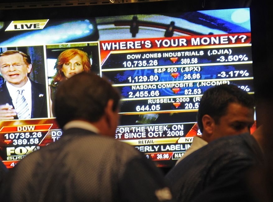 The screen on the floor of the New York Stock Exchange at the closing bell reflects a DOW loss of 389.56 points on Sept. 22, 2011, in New York. (Associated Press)