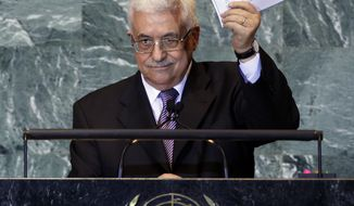 Palestinian President Mahmoud Abbas holds a letter requesting recognition of Palestine as a state as he addresses the 66th session of the United Nations General Assembly on Sept. 23, 2011, at U.N. headquarters. (Associated Press)