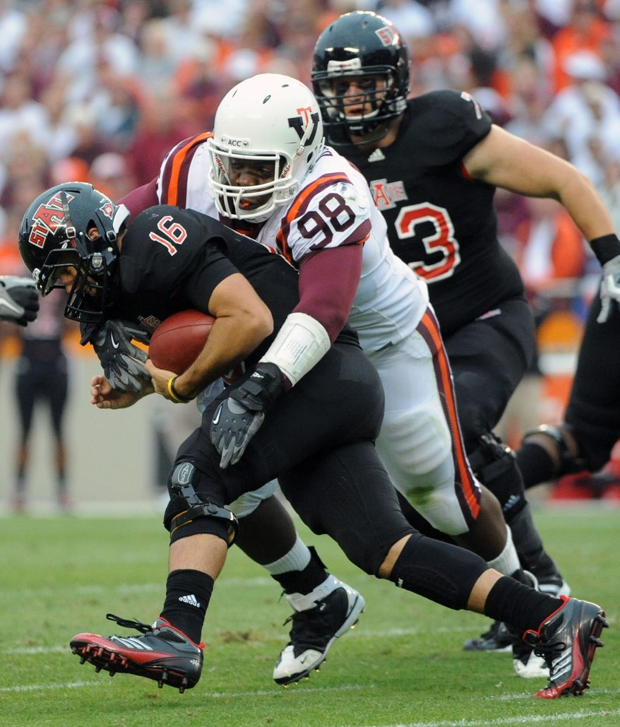 Virginia Tech's Derrick Hopkins (98) sacks Arkansas State's quarterback Ryan Aplin (16) during the second half of an NCAA college football game, Saturday Sept. 17, 2011, at Lane Stadium in Blacksburg, Va. (AP Photo/Don Petersen)