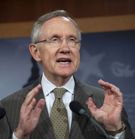 **FILE** Senate Majority Leader Harry Reid, Nevada Democrat, gestures during a Sept. 22, 2011, news conference on Capitol Hill to discuss FEMA funding and the continuing resolution to fund the government. (Associated Press)