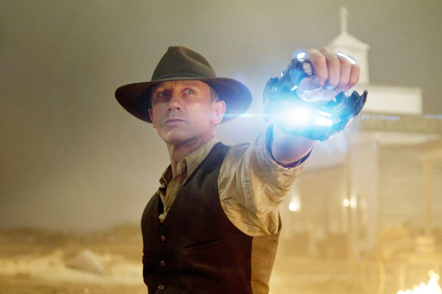 """Hollywood movies that performed poorly at the box office relative to what they cost to produce include """"Cowboys & Aliens"""" with Daniel Craig. (Associated Press/Universal Pictures)"""