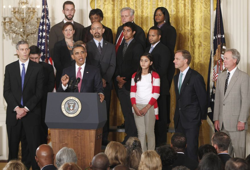 **FILE** President Obama stands with educators and students as he speaks Sept. 23, 2011, at the White House about No Child Left Behind Reform. Also seen are Education Secretary Arne Duncan (left), Tennessee Gov. Bill Haslam (second from right) and Rhode Island Gov. Lincoln Chafee (right). (Associated Press)