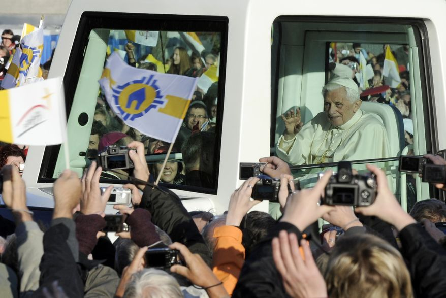Pope Benedict XVI arrives in his popemobile to celebrate an open air mass in front of the St. Mary's cathedral in Erfurt, central Germany, Saturday, Sept. 24, 2011. Pope Benedict XVI is on a four-day official visit to his homeland Germany. (AP Photo/Jens Meyer)